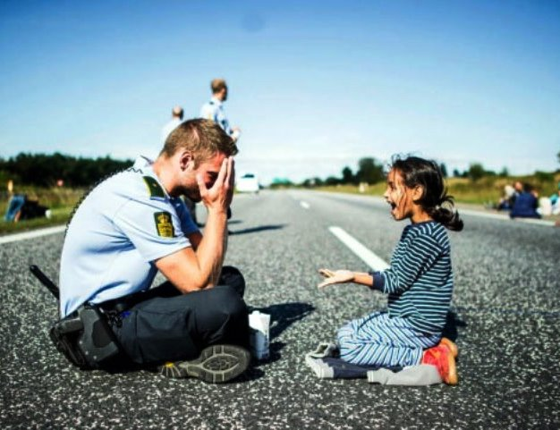danish-officer-syrian-girl